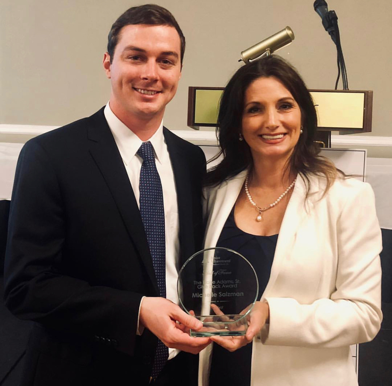 michelle receiving the blaise adams award